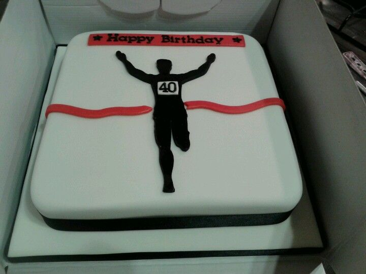 10 inch  birthday cake. chocolate sponge with ganache and buttercream. running theme male 40th