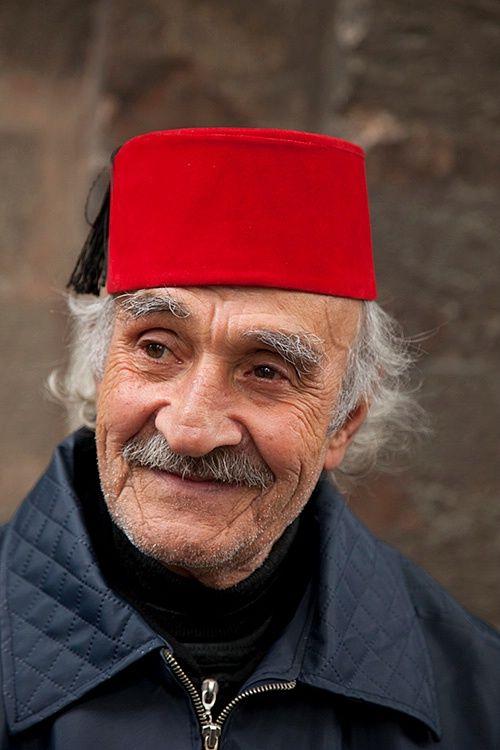 vendor of turkey slippers, istanbul, turkey