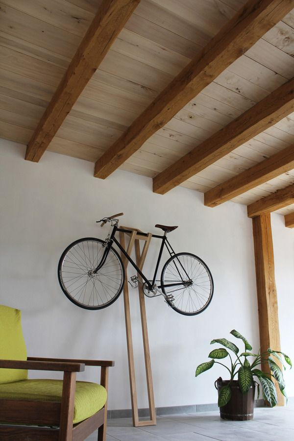 We NEED a new way to store our bikes that keeps them accessible, but frees up porch space.  Ceiling, maybe?