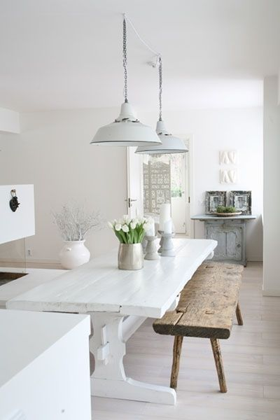 Love the white and bright look with the wood bench