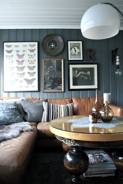 dark grey wall + brown sofa