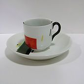Suprematist design coffee cup and saucer by Nikolai Suetin originally manufactured in the Petrograd Porcelain Factory in 1923 these reproductions are a limited edition made in Portugal for the Museum of Modern Art New York.