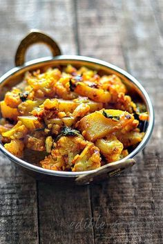 Aloo Gobi Recipe - Dry Aloo Gobi Sabzi Recipe - Potato Cauliflower Dry Curry  Sometimes when I make aloo gobi, I use the cauliflower core a  substitute for potatoes.