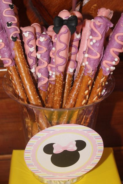 Chocolate dipped pretzels at a Baby Minnie Mouse Baby Shower!  See more party ideas at CatchMyParty.com!