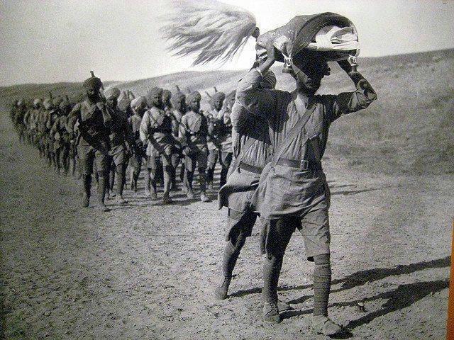 "Sikh soldiers carrying "" Guru Granth Sahib Ji"" during World War II."