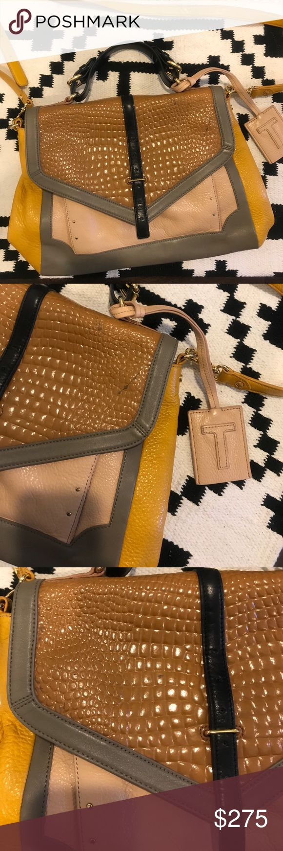 Tory Burch leather color block satchel purse Large size bag- great fall colors! A few small blemishes on the flap. See all pictures before purchasing! Multiple pockets and build in mirror. From Being Be blog. No trades. Tory Burch Bags Satchels
