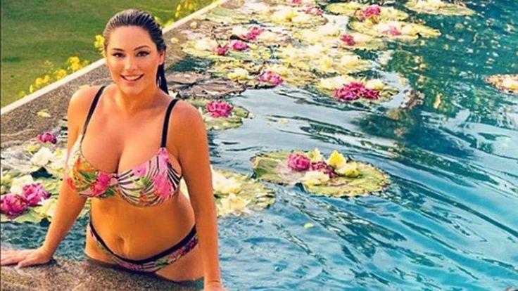 Kelly Brook flaunts her jaw dropping curves in a bath bikini