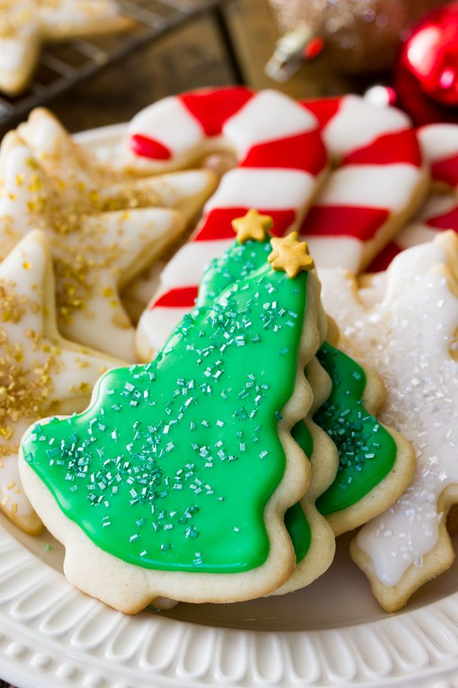 This is the BEST SUGAR COOKIE RECIPE with an easy sugar cookie frosting!    SugarSpunRun.com