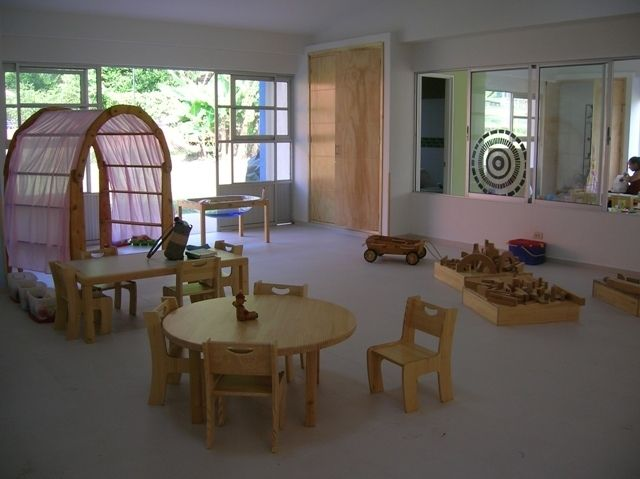 Beautiful classroom in a Reggio-inspired school.  I love the Waldorf tent frame draped in pink.