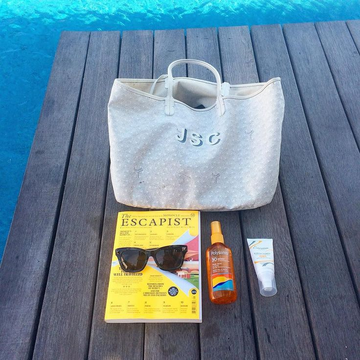 Poolside essentials at our new Bali hotel @alilaseminyak new The Escapist magazine from @monoclemagazine sunglasses @embryolisse sunscreen and favourite @maison_goyard bag. #traveloffen #embryolisse