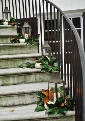 staircase decorated with magnolia leaves