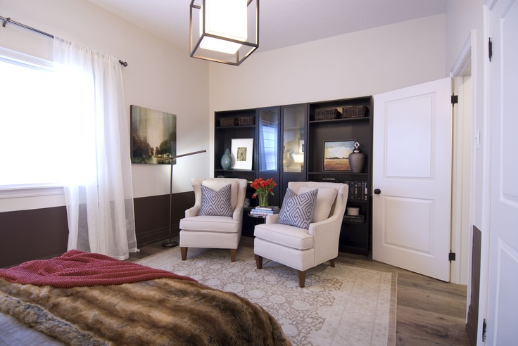 Seating area in master bedroom. If you use swivel chairs and had a TV in the cabinet behind it would be so functional.