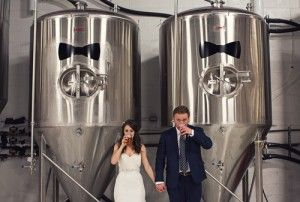 Beer fermentation tanks with a hoppily wed couple.