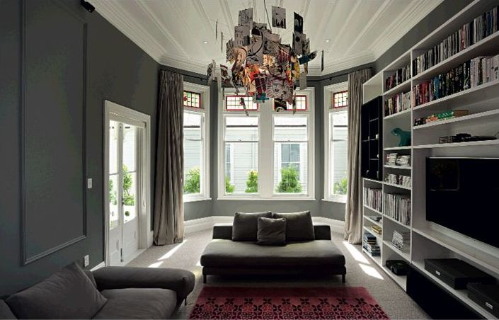 Great use of a charcoal in a living room - very cosy and modern.