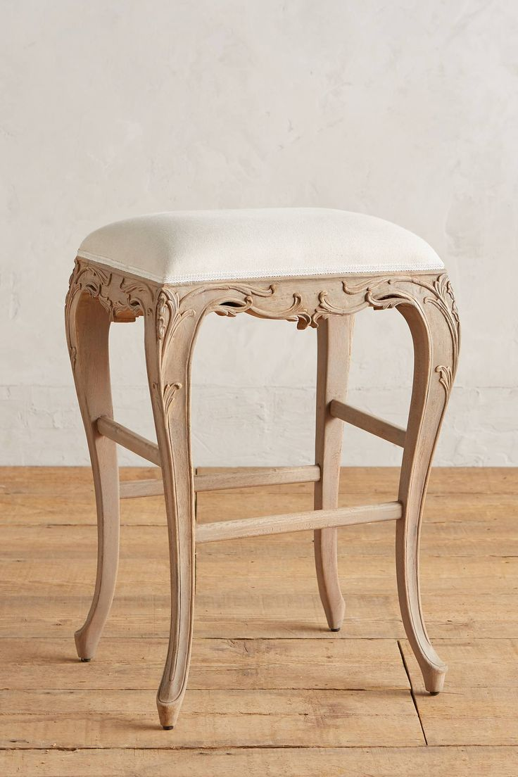 "Handcarved Lovella Bar Stool Linen upholstery; foam fill Handcarved mango wood frame; weathered finish Cabriole legs Professionally clean  Dimensions 30.5""H, 21""W, 18""D 29"" under stool clearance"