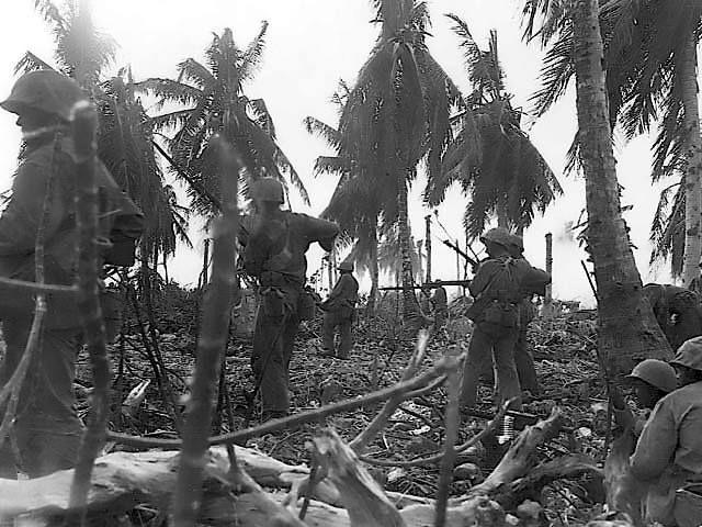 US Marines advancing on Eniwetok Marshall Islands 23 February 1944. Note bayonets fixed on rifles.
