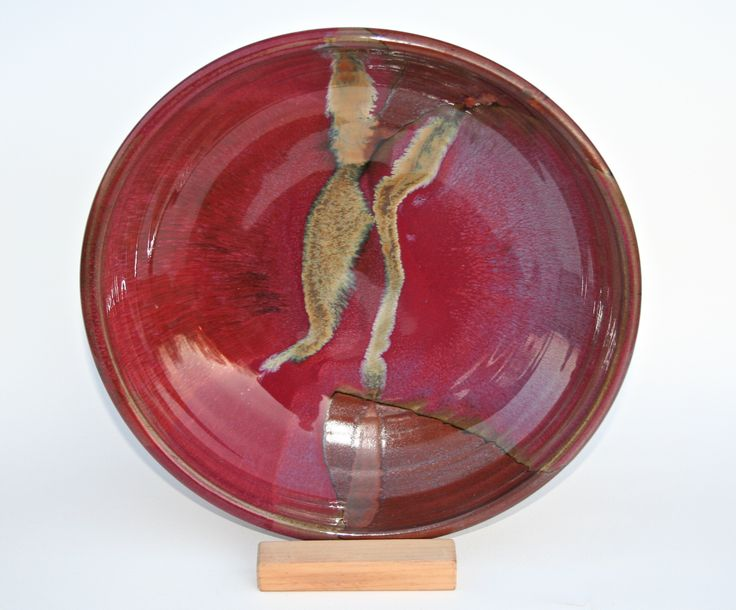 Chez Red / temoky: serving platter  - Glossy copper red glaze. Deep tones spanning from copper/rust to venetian reds.  Partnered with a matt brown, with lines of black where the glaze breaks on the edges.