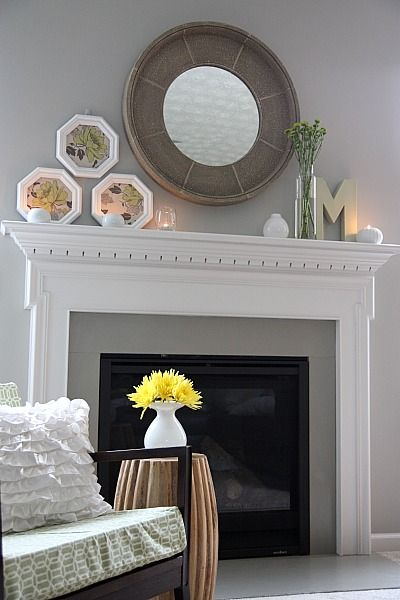 Fireplace with white mantel and surround. Maybe consider painting the brick a nice gray tone. Ben Moore has great gray colors such as revere pewter, smoke embers, and stoning ton gray.