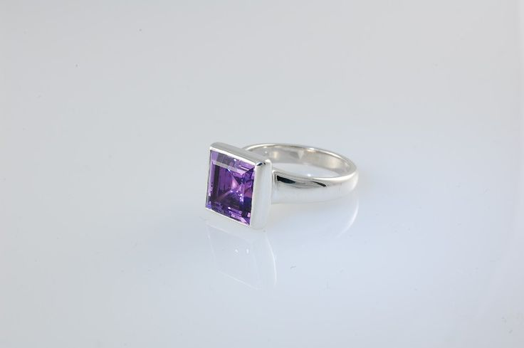 -CM613r- In sterling silver set with a  clean and clear square cut Amethyst.  This ring is sold. Let us create a special ring for you. Check out our website https://jewelbeetle.co.nz or our gallery on smugmug https://jewelbeetle.smugmug.com