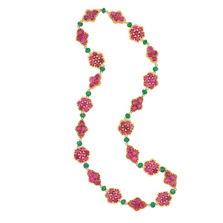 Indian Gold, Ruby and Emerald Bead Necklace The stylized floret plaques set with 63 round rubies, spaced by fancy-shaped plaques set with 44 oval rubies, total approximately 21.00 cts., all spaced by 20 emerald beads approximately 5.8 to 5.6 mm., approximately 35.2 dwt. Length 20 1/2 inches.
