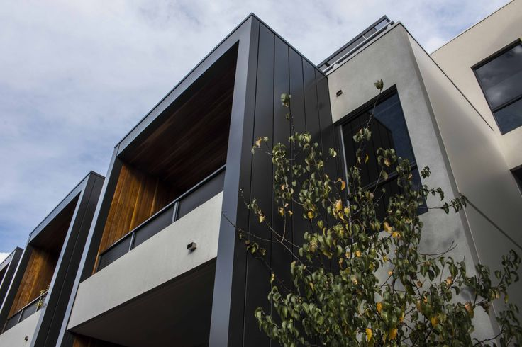 Argo Apartments, South Yarra by Rothe Lowman Architects, features our Interlocking wall cladding profile in Colorbond Steel's Monument. #metal #cladding #systems #metalcladding #metalcladdingsystems #metalfacade #claddingpanel #wallpanel #panel #sheetmetal #Colorbond #steel #home #houses #inspo #Melbourne #design #architectural #architecturalpanel #steelcladding