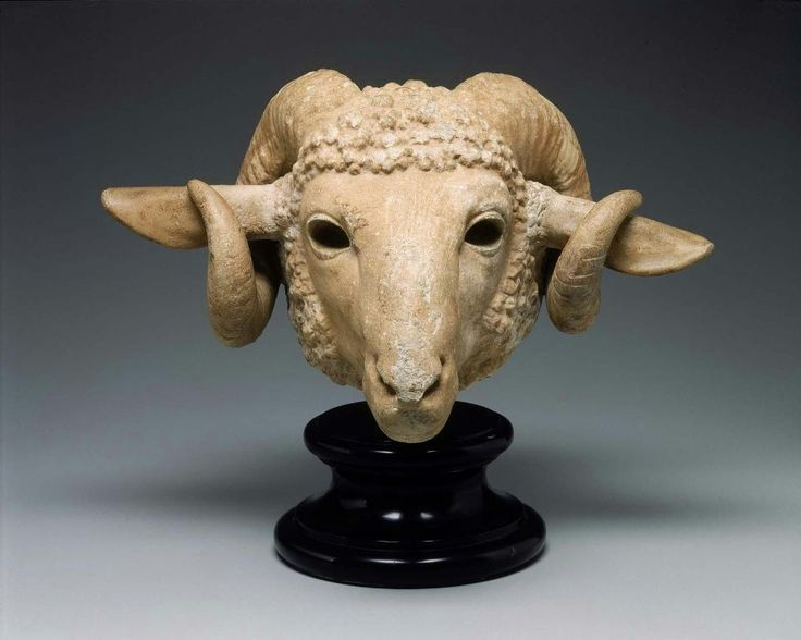 The ears are over-sized  and should lie back with the opening to the front. The horns should lie close to the sides of the head, as the re-worked fleece indicates. The eyelids have been patched with plaster. Eyes Inserted. Scientific Analysis: University of South Florida Lab No. 8402: Isotope ratios - delta13C +5.1 / delta18O -3.5, Attribution - Paros 1. Justification - C and O isotopes, medium grain. Ram's head. Greek, Late Classical Period, prob. 4th C.  BCE