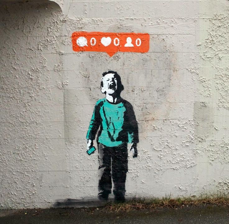 """Nobody Likes Me"" is the newest offering by Canadian Street Artist I♥ to the streets of Vancouver, a coastal seaport city on the mainland of British Columbia. Describing himself as ""Just a boy with ideas, opinions and a whole lot of aerosol."", I♥ nailed it with this simple but powerful stencil of a young boy and his Instagram problems."