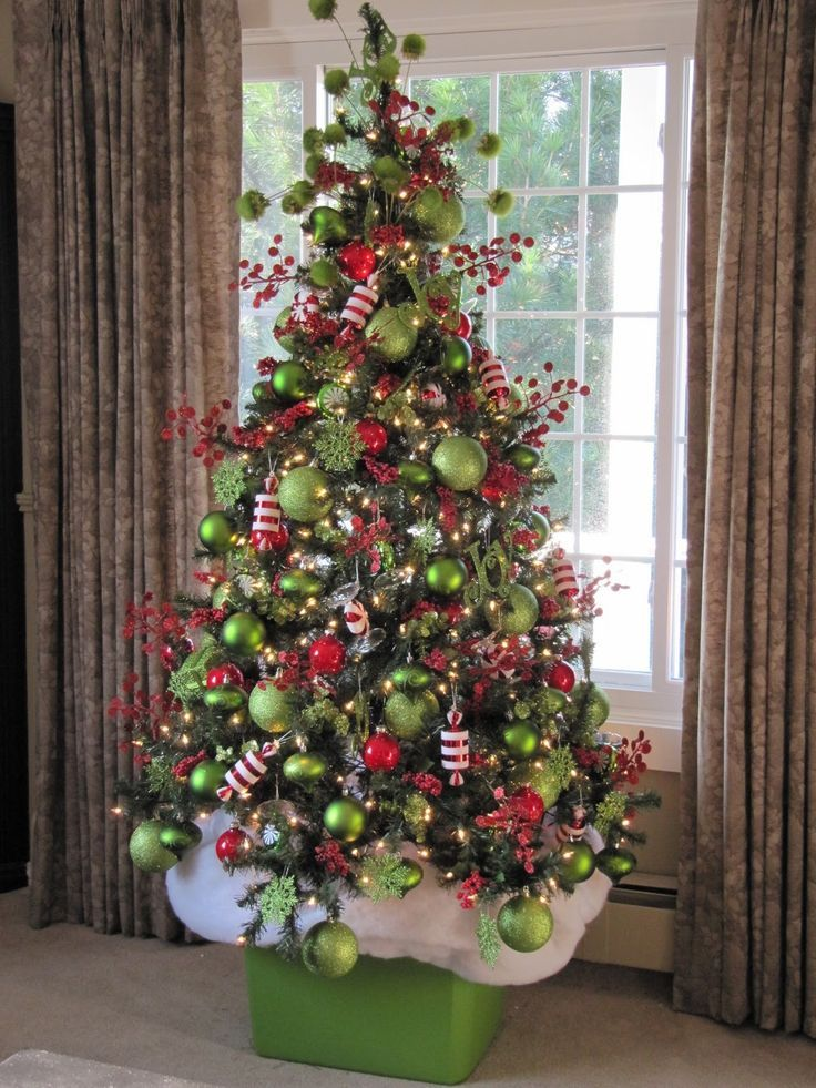 Christmas Tree Like The Box Idea Instead Of Just Covering The Bottom With A Skirt Grinch Christmas Tree Grinch Christmas Decorations Green Christmas Tree