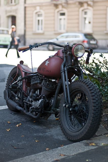 Old school.  Harley WLA turned into a bobber, like the WWII vets would have made when they returned home.  Cool springer front end and flared fishtail