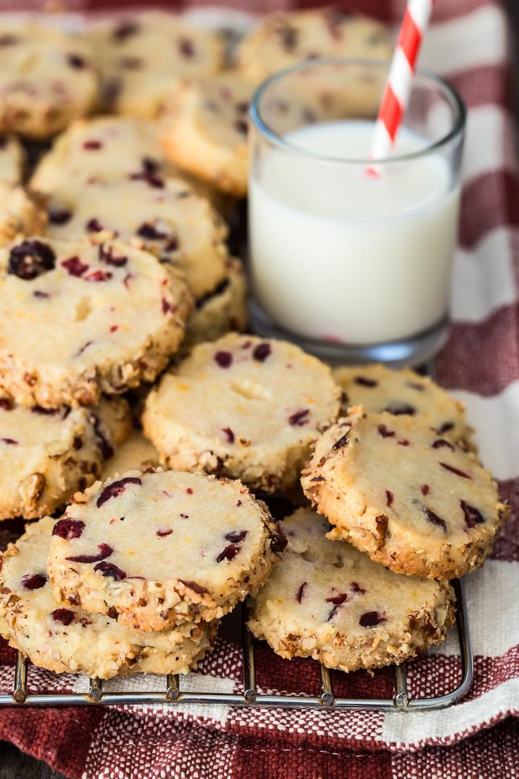 Fresh baked Cranberry Orange Cookies with a crunchy toasted pecan edge. These might be the perfect Christmas cookies for Santa!
