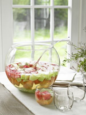 - ½ cup sugar - 3-5 tablespoons brandy - 1 (750-milliliter) bottle white wine, chilled - Melon (such as watermelon, cantaloupe, and honeydew), diced - Grapes, halved - 1 (1-liter) bottle club soda  1. In a large pitcher, stir sugar and brandy until paste-like mixture. 2. Add wine and fruit. 3. Refrigerate to keep chilled until ready to serve. 4. Pour into punch bowl and add club soda.  Read more: Punch Recipes with Alcohol - Easy Alcoholic Punch Recipes - Country Living