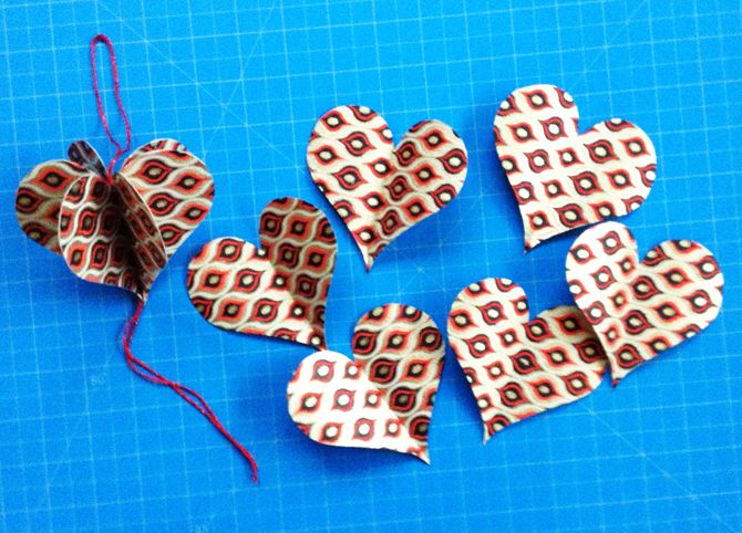 DIY Hanging Paper Heart Ornaments from six hearts folded in half....