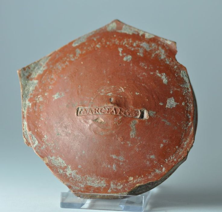 Samian pottery stamp, samian vase potter makers' name, potter name, potter signature, 2nd-3rd century A.D. Samian pottery stamp, samian vase potter makers' name, potter name, potter signature, bottom of a cup with maker's name MARCIANUS, 8 cm diamater. Private collection