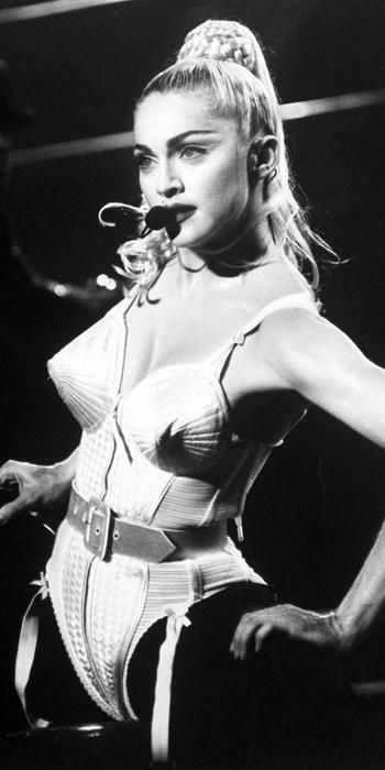 """Madonna's Most Iconic Looks Ever - 1990 from #InStyle """"Madonna doesn't take on trends, she creates them"""" - hairstlyist Andy LeCompte Madonnas collaboration with French courturier Jean Paul Gaultier has resulted in many iconic looks throughout the years. The famous cone bra look put both Madonna and Gaultier on the map. It is an example of how one look can catapult your popularity as an artist."""