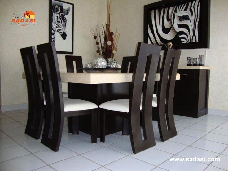 #lasmejorescasasdemexico LAS MEJORES CASAS DE MÉXICO. Un comedor de madera con sillas en blanco y negro, lo puede combinar a la perfección con ligeros tonos beige en paredes o techos. Este espacio se puede complementar, colocando cuadros que contrasten con el comedor. En Grupo Sadasi, esperamos su llamada para adquirir su casa en nuestro desarrollo LOS HÉROES LEÓN, ubicado en Guanajuato. (477)3300080.