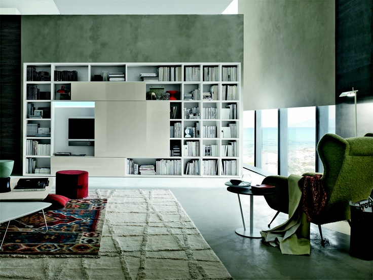 Tomasella Group storage system.  Love the mother of pearl sliding glass doors that cover books or tv! TheHome.com #hpmkt