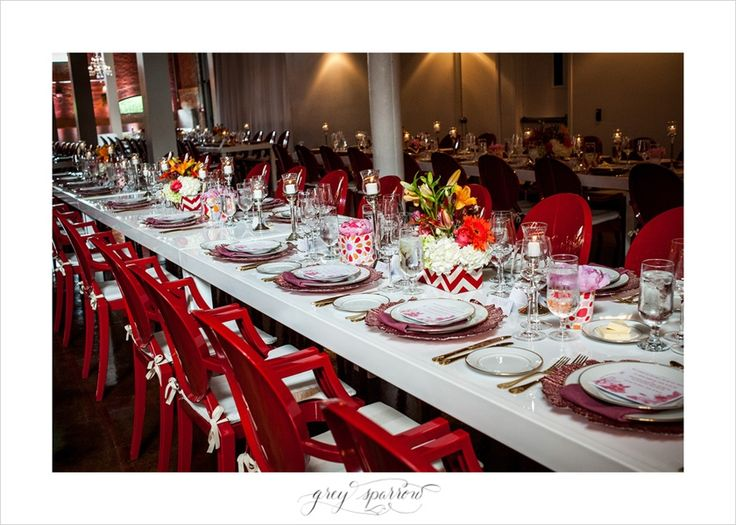 long white table and pink chargers