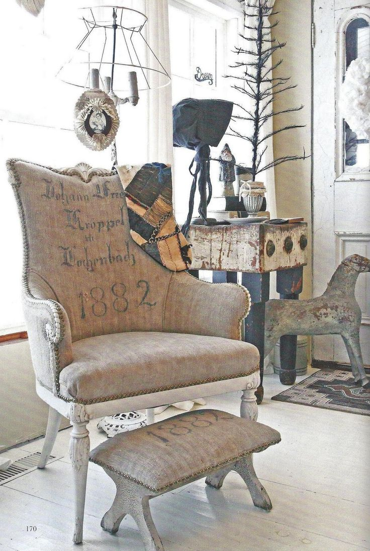 Classic Style  Love the writing on this chair and very cute footstool