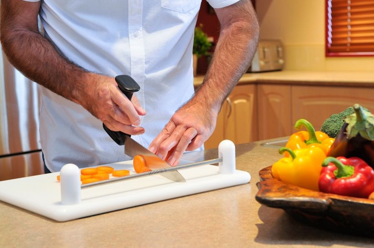 "Cibocal Classic-Stirex U2 Knife Set - cutting a carrot using the Stirex U2 8"" Ergonomic Chef Knife. This combination of chopping board & knife works particularly well for people with very limited strength, hand function or dexterity. The Classic or Classic Lite works equally as well with the Stirex knife."