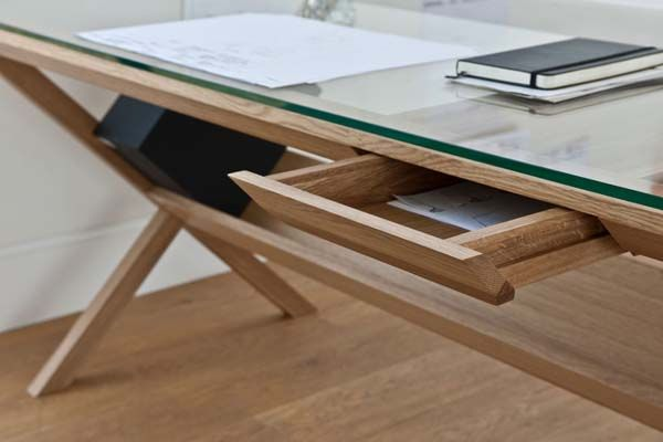 There are many good furniture designs, a lot of different materials that compose a beautiful desk. Some of them save space in the room because a designer c