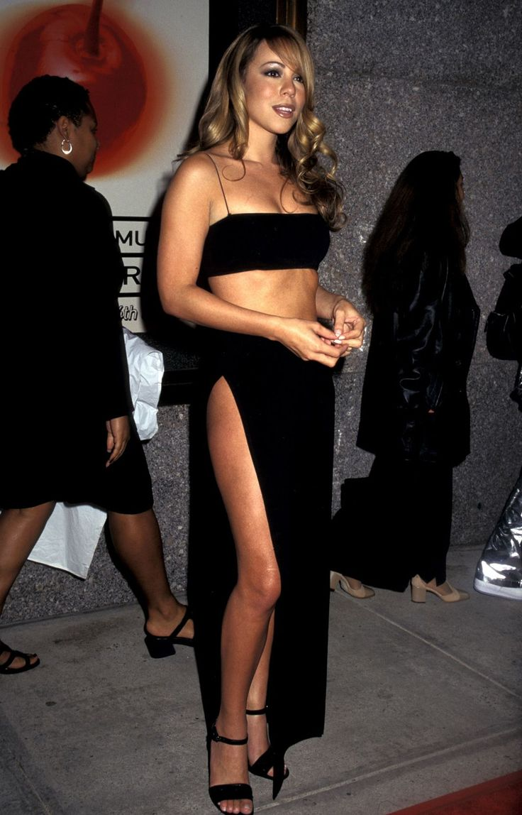 12 '90s Mariah Outfits That Prove She Has Range #refinery29  http://www.refinery29.com/mariah-carey-lookbook-throwback-90s-fashion#slide-6  A bandeau and split maxi-skirt, tumbling curls, and not much else....