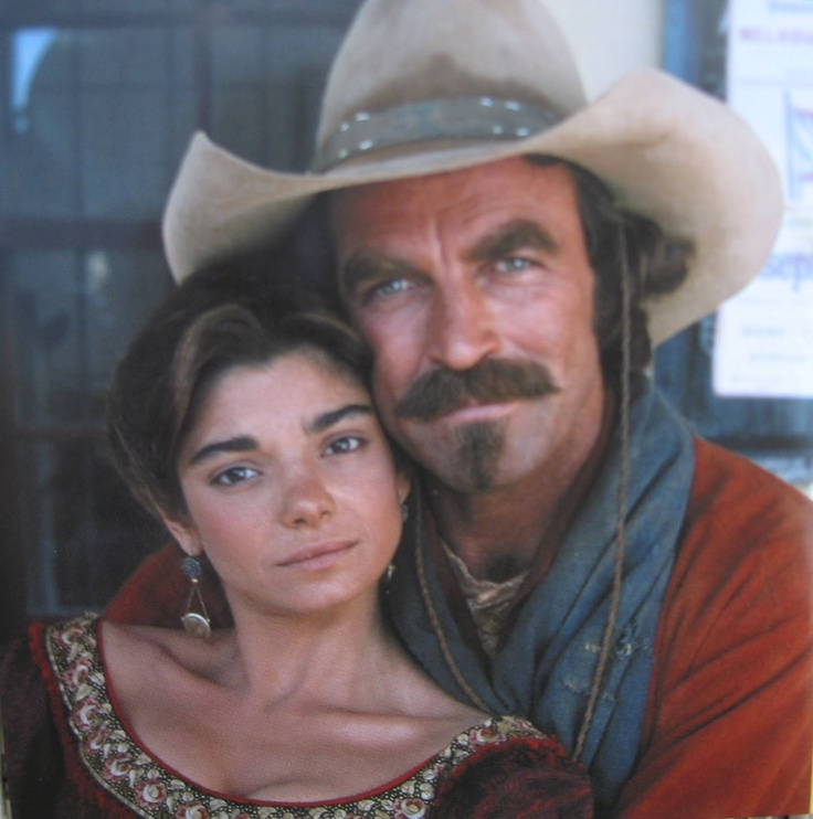 """Quigley 'Tom Selleck' and Cora 'Laura San Giacomo' from """"Quigley Down Under"""", (1990)."""