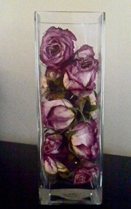 dried roses in a vase ...love this!