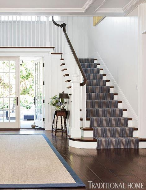 Hillside home in California Carpet on stairs with wood flooring