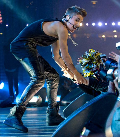 Justin Bieber rocks out in leather — Loving the custom Supra Skytop II's, and the leather pants actually don't look too bad :)