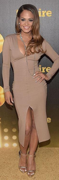 Who made Christina Milian's tan long sleeve dress?
