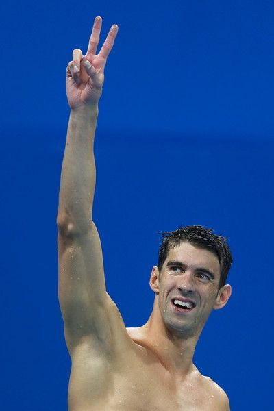 Michael Phelps Photos Photos - Michael Phelps of the United States celebrates winning gold in the Final of the Men's 4 x 100m Freestyle Relay on Day 2 of the Rio 2016 Olympic Games at the Olympic Aquatics Stadium on August 7, 2016 in Rio de Janeiro, Brazil. - Swimming - Olympics: Day 2