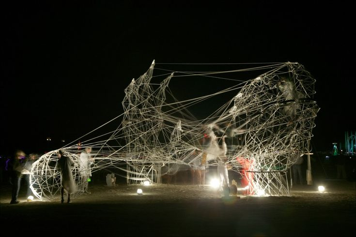 This string and metal art installation, shown in a time-lapse photo, let passers-by play it with provided instruments