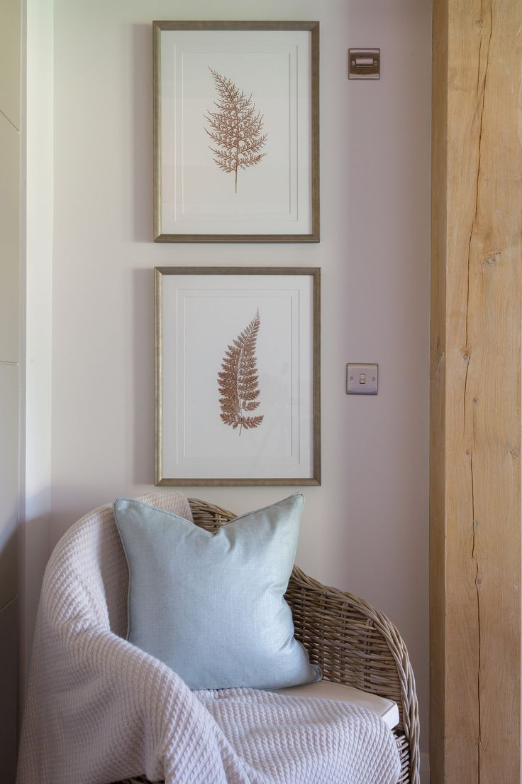 Drawing the eye gently down the pair of characterful prints towards this Rattan-style armchair, you peacefully descend into the calm, country-feel of our contemporary Surrey barn project - all with a light pop of colour from this beautiful Romo Fabrics cushion.