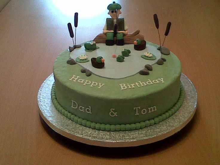 Fishing Birthday Cake - This is a Maderia Cake that I made and decorated with fondant icing. I then created all of the figures to go on the cake. This took me a bit of time but I think that it was worth it!